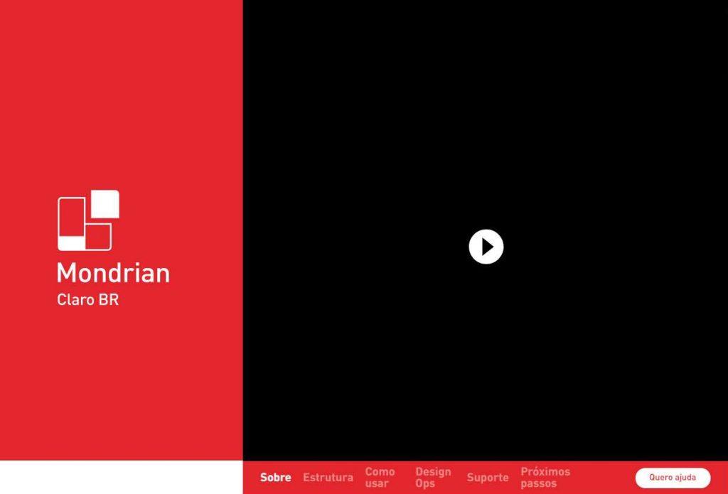 home do design system mondrian. Na lateral esquerda um fundo vermelho com o logo Mondrian Claro BR em branco. Do lado direito um video totalmente preto ainda nao iniciado. Em baixo desse video o menu contendo itens como sobre, estrutura, suporte, etc.